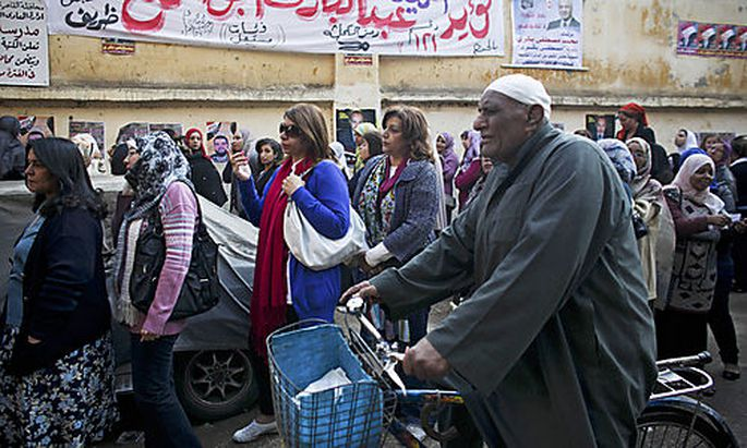 Egyptian women queue to vote in Maadi, a suburb of Cairo, Egypt, Monday, Nov. 28, 2011. Voting began
