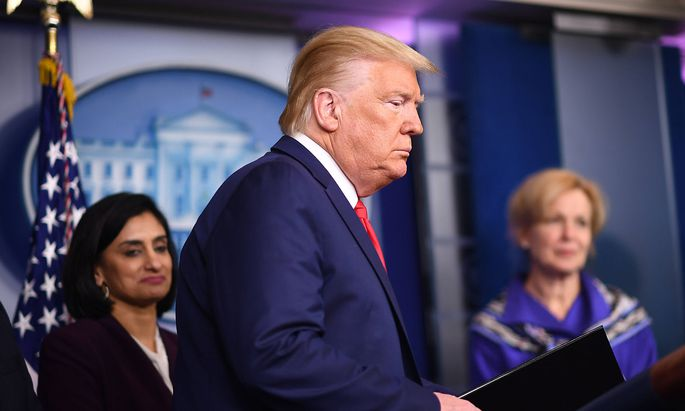 President Donald Trump arrives to deliver remarks on the COVID-19 (Coronavirus) pandemic alongside members of the Corona