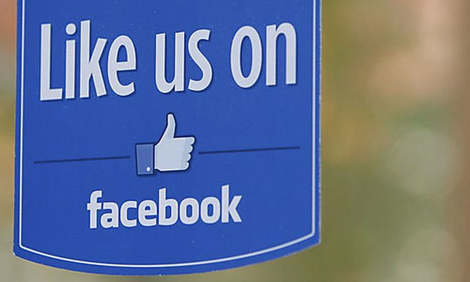 FILE - This Dec. 13, 2011 file photo shows a sign at Facebook headquarters in Menlo Park, Calif. Fac