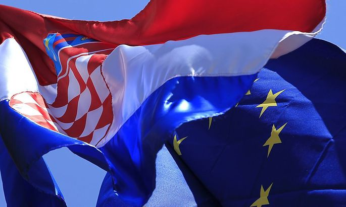The European Union and Croatian flag is seen in Zagreb's downtown