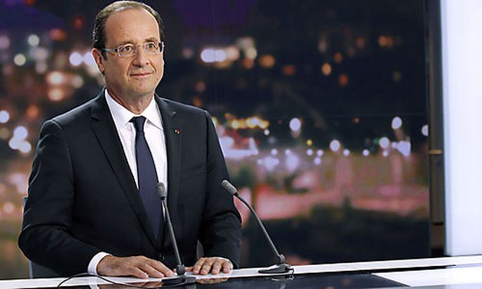 France's President Hollande is seen at the French Television France 2 studios ahead of his appearance