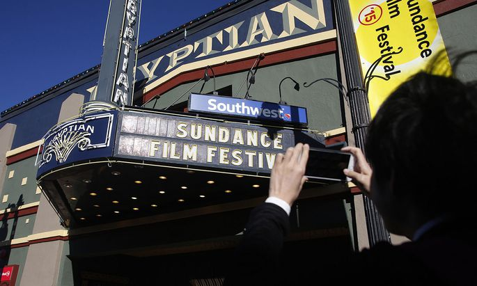 People take photos at the Egyptian Theatre before the opening day of the Sundance Film Festival in Park City, Utah before the opening day of the Sundance Film Festival in Park City, Utah