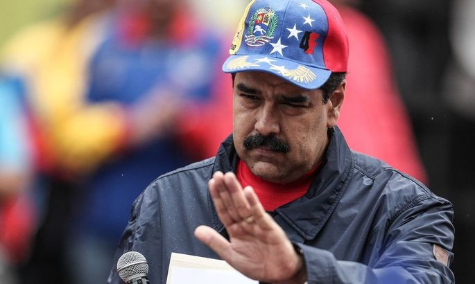 160501 CARACAS May 1 2016 Venezuela s President Nicolas Maduro takes part in an event to c