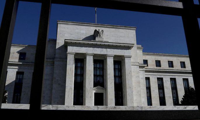 Die US-Notenbank unterstützt die von der Coronakrise 2020 hart getroffene Wirtschaft noch immer mit monatlichen Wertpapierkäufen in Höhe von 120 Mrd. Dollar.