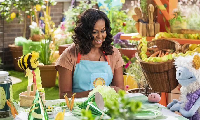 Michelle Obama mit dem murmelnden Reiskuchen Mochi und Waffel, dessen Vater ein Yeti war.