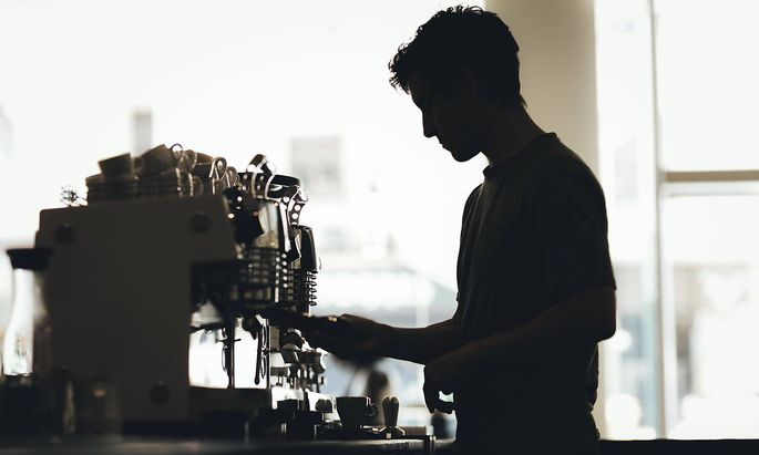 Silhouette of Barista preparing coffee in a coffee bar model released Symbolfoto property released