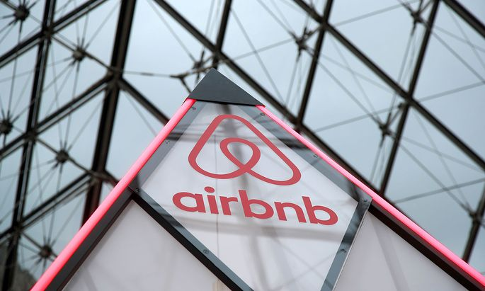 FILE PHOTO: Airbnb logo is seen on a little mini pyramid under the glass Pyramid of the Louvre museum in Paris