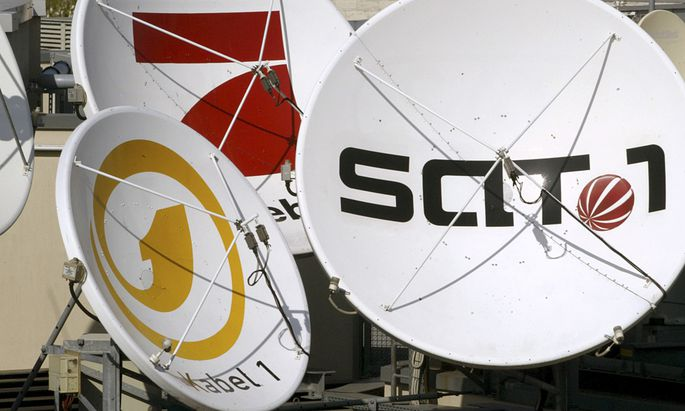 File photo of satellite dishes of the German television stations Kabel 1, SAT 1 and Pro Sieben on the roof of the company´s office in Berlin