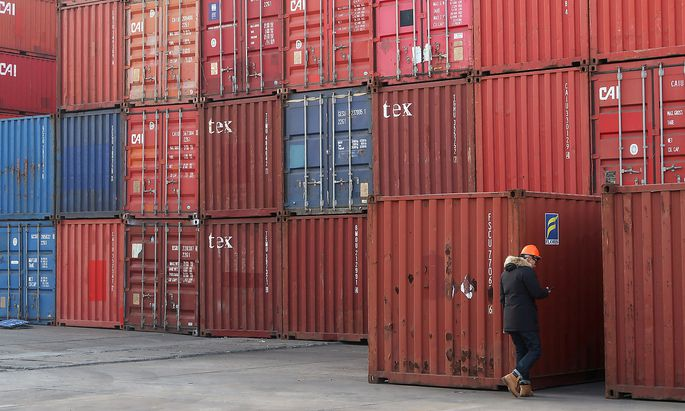 FILE PHOTO: Worker checks containers at a logistics center near Tianjin port, in Tianjin, China