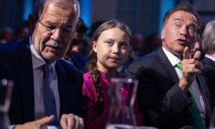 Alexander Van der Bellen, Greta Thunberg und Arnold Schwarzenegger.