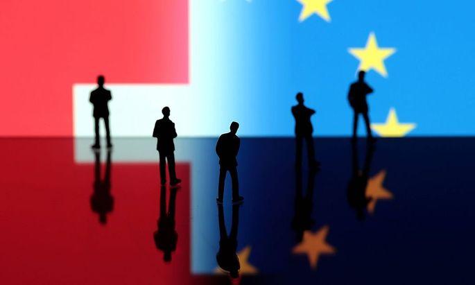 Symbold zum Referendum in der Schweiz zwecks Begrenzung der Zuwanderung von Buergern und Arbeitnehme