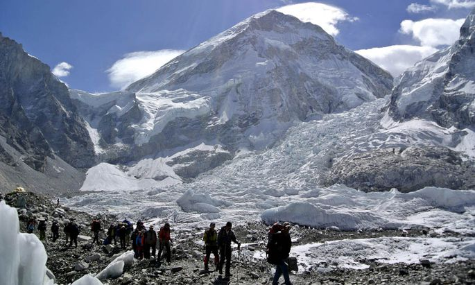 File picture shows climbers walking towards their helicopter after their Mount Everest expeditions were cancelled in Solukhumbu district, Nepal