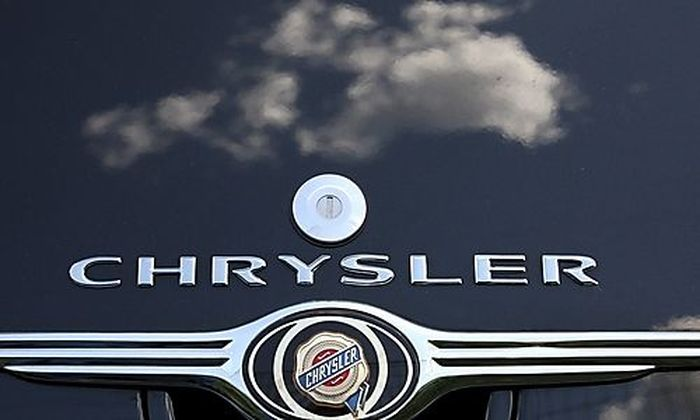Clouds are reflected on a Chrysler PT Cruiser at a Chrysler dealership in Rome