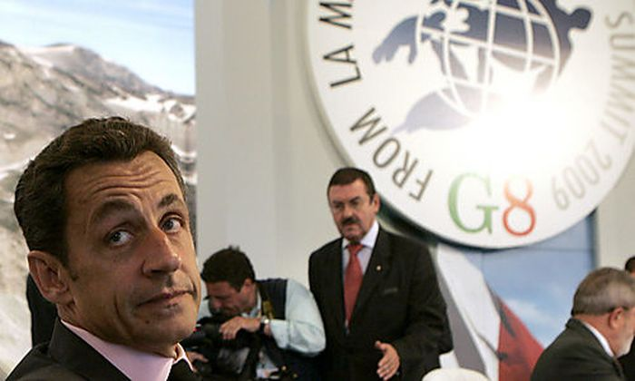 French President Nicolas Sarkozy attends a round table meeting of the G8, G5 and Egypt during the G8