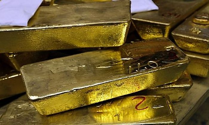 FILE - In this May 13, 2008 file photo, gold standard bars are piled up at the gold smelter company A