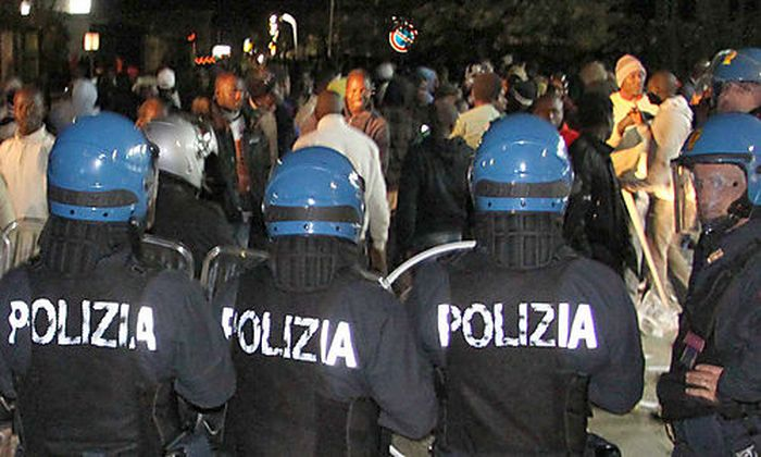 In this photo taken Jan. 7, 2010 made available Friday Jan. 8 2010, Italian police officers in riot g