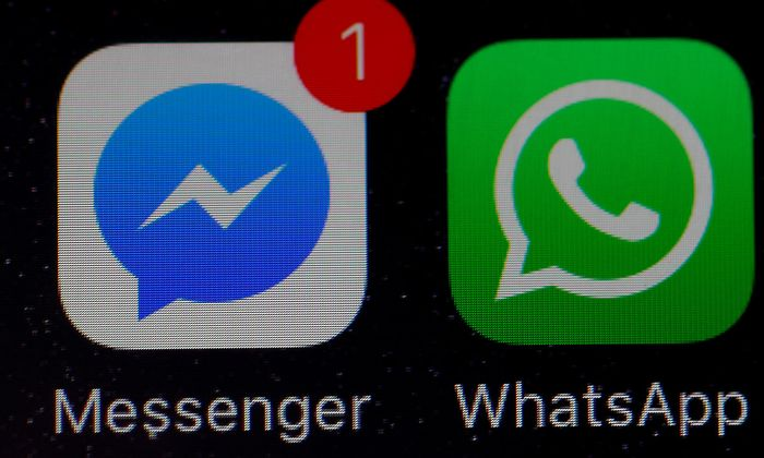 Facebook messenger icons are seen on an iPhone in Manchester, Britain