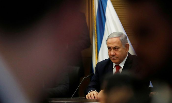 Israeli PM Netanyahu looks on during his Likud party faction meeting at the Knesset in Jerusalem
