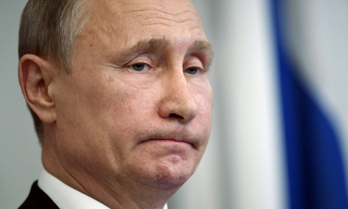 Russian President Vladimir Putin reacts during a joint news conference with Finnish President Sauli Niinisto, at the Hotel Punkaharju in Savonlinna