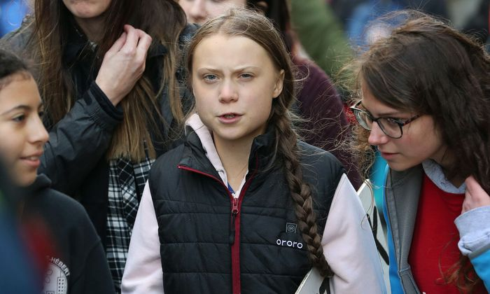 Swedish teen activist Greta Thunberg arrives for the post federal election Friday climate strike march starting and end