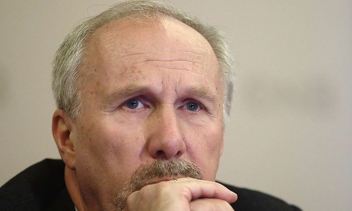 Austrian National Bank Governor Nowotny listens during a news conference in Vienna