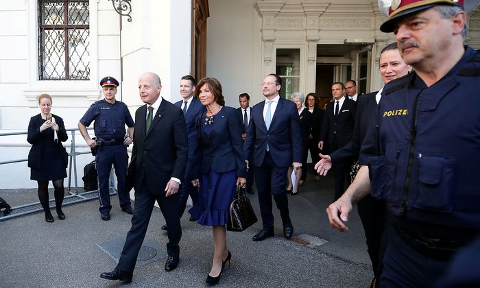 Austrian President Alexander Van der Bellen swears in the provisional cabinet of civil servants in Vienna