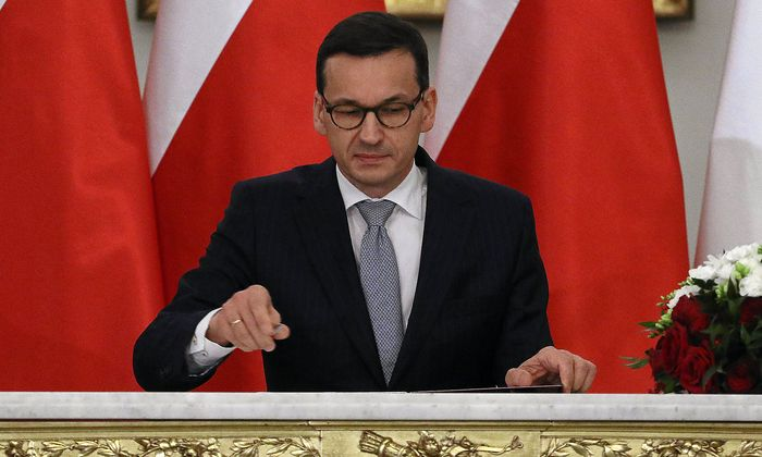 Newly appointed Polish Prime Minister Morawiecki reacts after receiving his nomination from President Duda during a government swearing-in ceremony in Warsaw