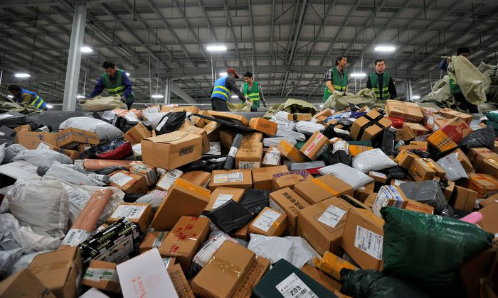 Employees sort boxes and parcels at a logistic centre of BEST Express delivery company, after the Singles´ Day online shopping festival, in Jinan