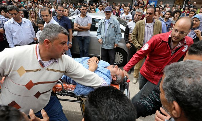 A victim is seen on a stretcher after a bomb went off at a Coptic church in Tanta