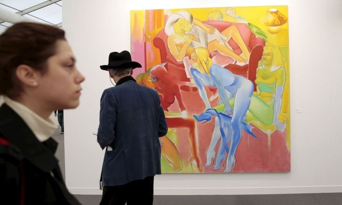 A visitor looks at 'The Visitor' by Allen Jones at the Frieze Art Fair in London, Britain