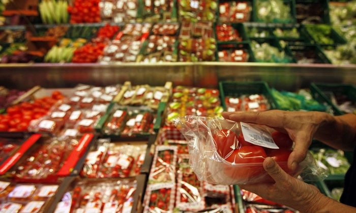 An employee of Czech Agriculture and Food Inspection Authority takes a sample of vegetables at a supermarket in Prague