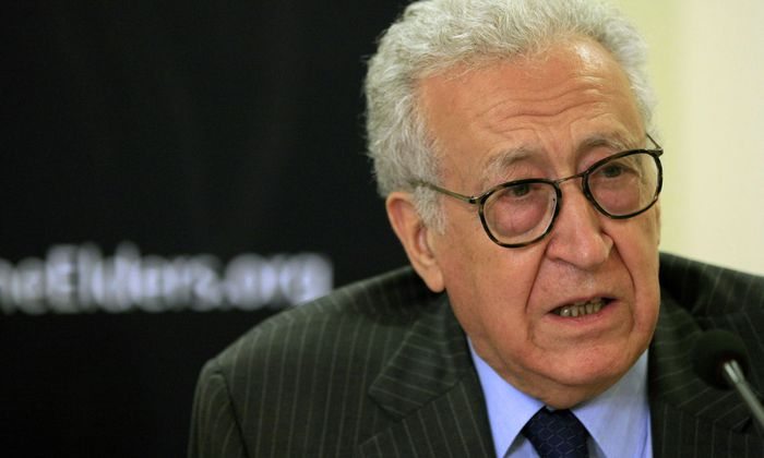 Diplomat Lakhdar Brahimi speaks with former U.S. President Jimmy Carter (not pictured) during a joint news conference in Khartoum