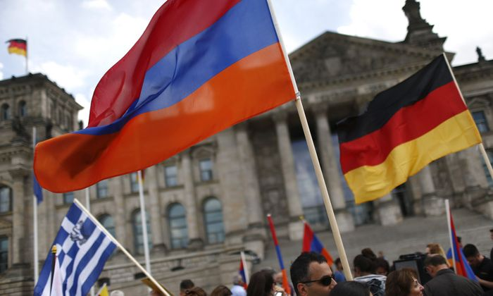 Supporters wave Armenian and German flags in front of the Reichstag in Berlin