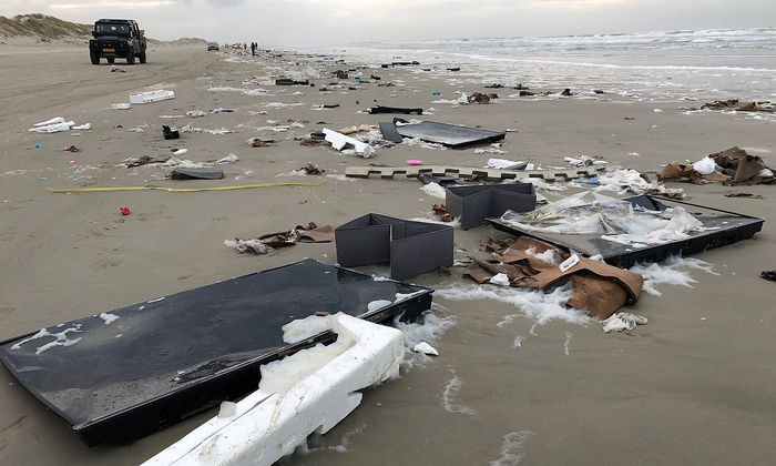Flat-screen TVs and debris lie washed up on beach in Terschelling