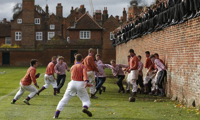 The Collegers and the Oppidans teams compete during the Eton Wall Game at Eton college