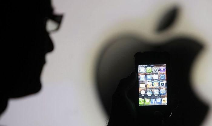 File photo illustration of a man posing with Apple iPhone 4 smartphone in Zenica