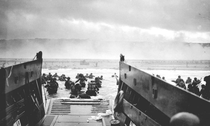 Handout photo of U.S. troops wading ashore from a Coast Guard landing craft at Omaha Beach during the Normandy D-Day landings near Vierville sur Mer