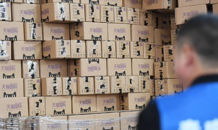 HANGZHOU CHINA NOVEMBER 11 Tmall Global packages pile up at a logistics base during Alibaba Gro