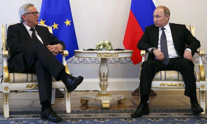Russian President Putin meets European Commission President Juncker in St. Petersburg
