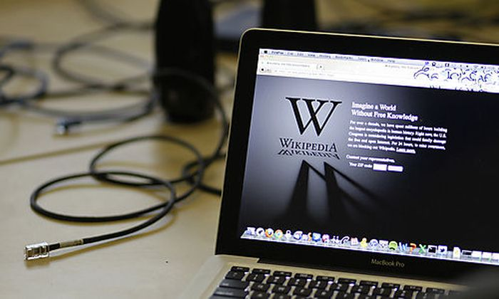 A blackout landing page is displayed on a laptop computer screen inside the Anti-Sopa War Room at t
