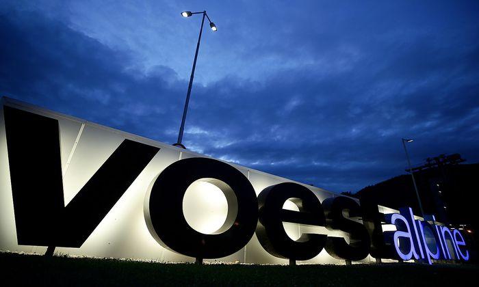FILE PHOTO: The logo of steelmaker Voestalpine stands in front of the steel plant Donawitz in Leoben