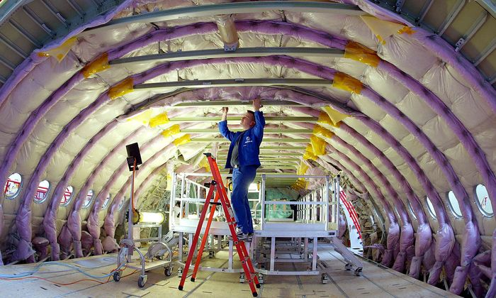 FILE PHOTO: A technician works inside the cabin of the first equipped fuselage sections of the new 555-seat superjumbo Airbus A380 at the Airbus facility in Finkenwerder near Hamburg