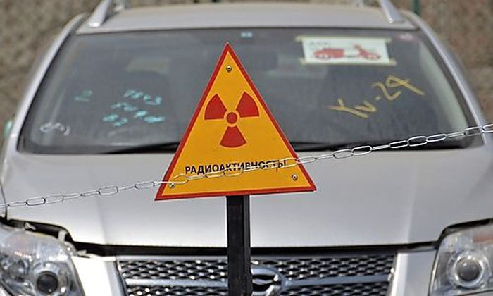 A car delivered from Japan is seen behind a sign at the port of Russias far eastern city of Vladivoss far eastern city of Vladivos