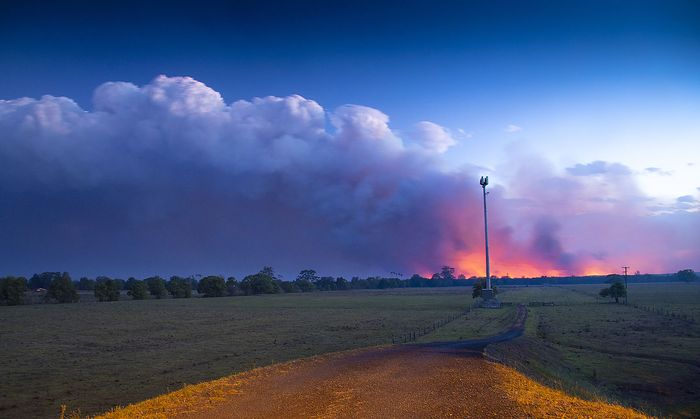 BUSHFIRES NSW, ***FILE***Smoke and fire is seen in the distance near Rainbow Flats, NSW, Friday, November 8, 2019. At l