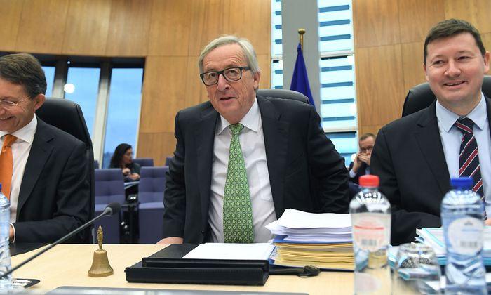 Kommissionsvorsitzender Juncker (l.) muss die Regierungen von seinen Euro-Plänen noch überzeugen.