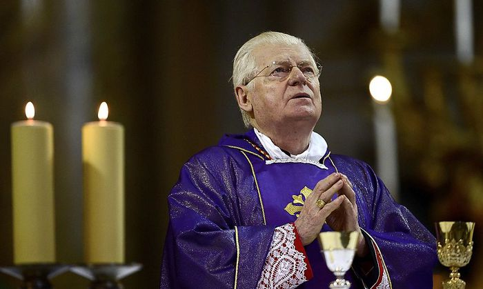 Cardinal Angelo Scola of Italy prays as he gives mass at the Santi XII Apostoli in Rome