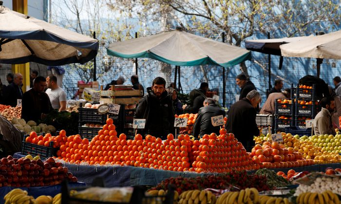 A stallholder waits for customers at a bazaar in Ankara