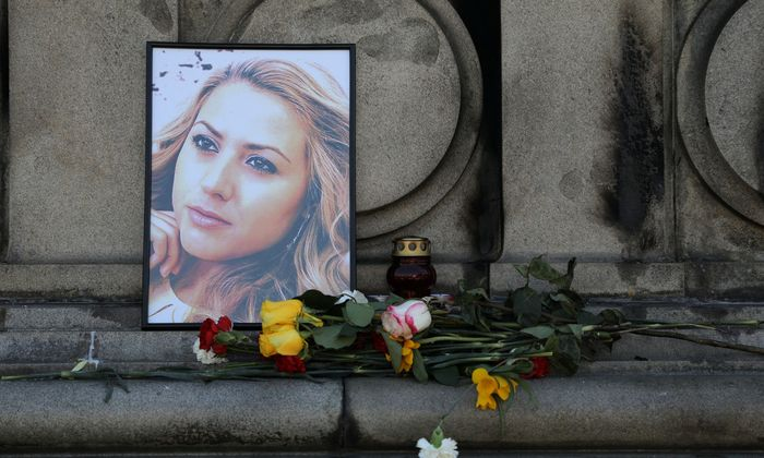 Flowers and candles are placed in memory of Bulgarian TV journalist Viktoria Marinova in Ruse