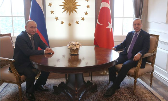 Turkish President Recep Tayyip Erdogan right with Russia s President Vladimir Putin prior to their