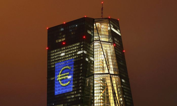 Headquarters of the European Central Bank (ECB) is seen illuminated with a giant euro sign at the start of the ´Luminale, light and building´ event in Frankfurt
